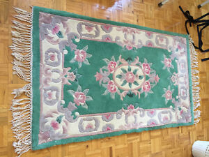 Three small wool rugs 3' x 5'