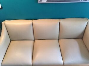 Reupholstered white leather couch.