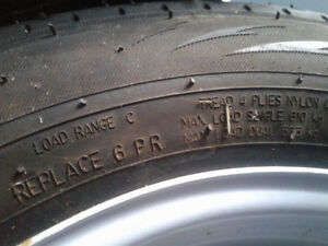 Trailer tires and rims....new this year...Used 1 time...