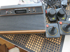 vintage Atari CX2600A console and games
