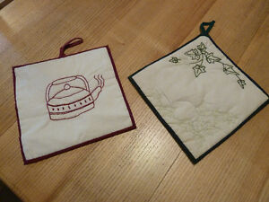 Hand made set of 2 hot pads embroidered with ivy and tea kettle