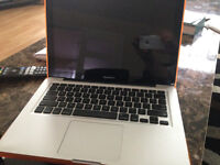 2011 macbook pro with 8 gb ram and SSD and hard shell