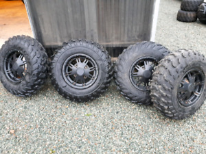 4 trail wolf tires on factory can am wheels