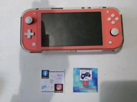 Switch lite pink + 2 games