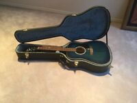 Guitar with hard cover case and suede strap