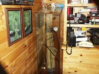 Antique set of golf clubs in glass cabinet
