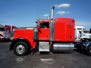 2009 Peterbilt 388 flat top with 46,000 rears