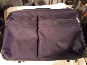 Suitcase 20 inches long by 15 in a very good condition