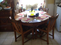 Antique solid oak round dining table with leaf and 4 chairs