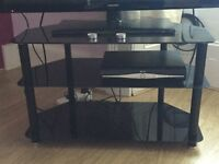 "Black glass TV stand (holds 43"" TV) ** Quick Sale**"