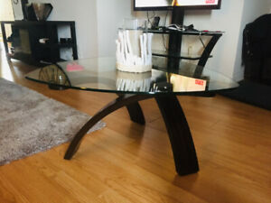 Stunning glass top coffee table with solid wood base