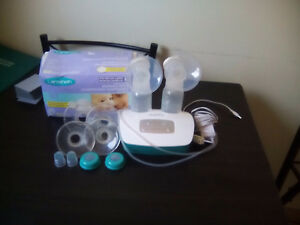 double electric breast pump and black garbage of girl clothes