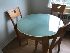 Round glass top dining table with chairs