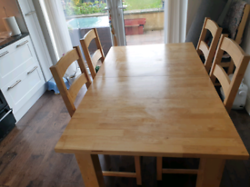 Solid wood dining table and six chairs.