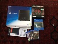 PS4 500GB with two controllers , 3 games , fan cool stand and gaming headset