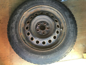 Used winter tires 195/65R15 on rims and hubcaps