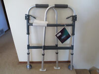 NEW INVACARE HEIGHT ADJUST ALUMINUM WALKER WITH WHEELS AND SKIS