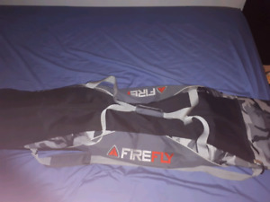 Firefly snowboard with bindings, boots and carry bag