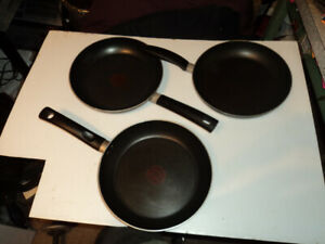 "Three 10"" T-fel frying pans"