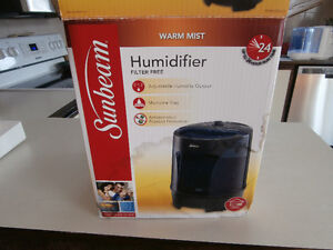 One sunbeam humidifier filter free with hot steam and germ cont