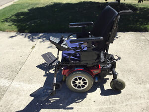 Quantum mobility power chair and a jazzy pride