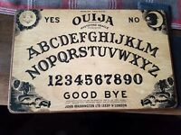 Ouija board William fuld type mobile phone telecommunications for the dead