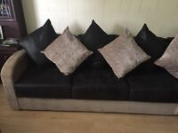 Black and mink sofa with a pull out double bed
