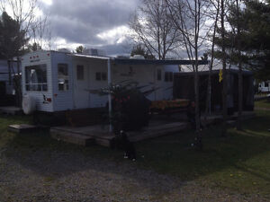 """26"""" Mallard Camper with Tipout. On a beautiful campsite lot"""