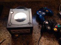 Gamecube + 2manettes + SuperSmash/MarioParty6 (individuel)