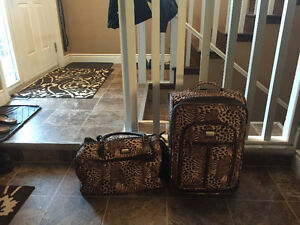 Mint condition Cheetah print carry on luggage