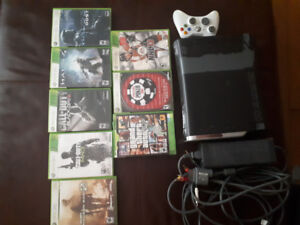 X-box 360 with 2controllers and 7 games. 200$