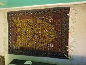 Authentic Persian Rug, of red/brown/green colours, medium size