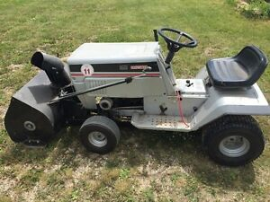 Riding mower with snowblower