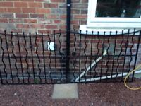 "wrought iron , black ,1meter high at the middle and 8ft 1"" opening"