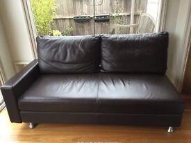 Delta 2x black leather sofas and 1x ottoman