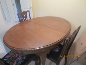dining room table with 6 chairs and 3 table inserts