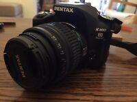 Pentax K100D Super SLR digital camera, 18-55mm lens and bag