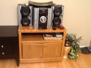 Cd and cassette player with cabnet with cd's and cassettes