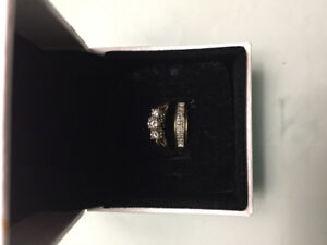 Trinity style engagement ring with band