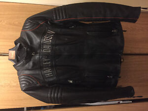 2 ladies Harley Davidson  riding jackets and boots