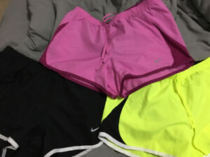 Nike running shorts in black, yellow, and pink (XS) $20