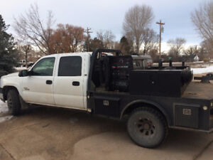 Welder and 2005 3500 GMC Duramax flat bed Quad