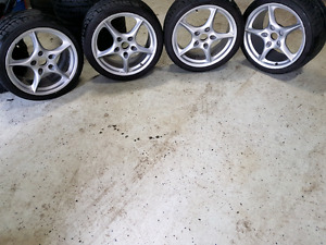 Porsche 911 OEM 18 inch wheels and tires staggered.