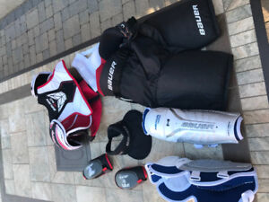 Youth hockey equipment set with roller bag