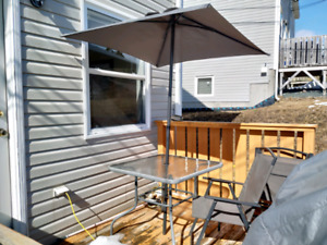 Patio set: glass table, umbrella and four chairs