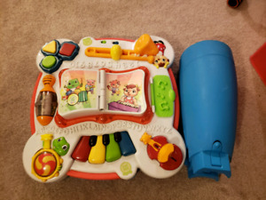 Portable activity table for sitting or standing toddlers
