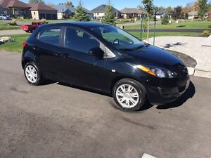 2012 Black Mazda 2 GX sports hatchback. Low kms!