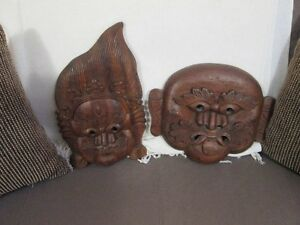 2 wood carved masks ready to hang