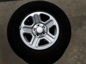 Set of 5 Goodyear Wrangler Tires on Jeep Rims