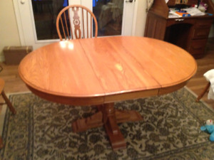Oak dining table with leaf extension